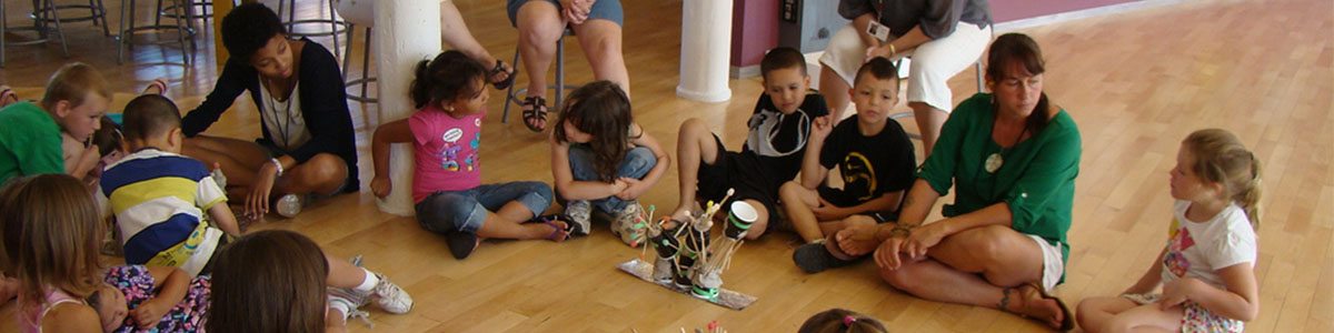 Group of students participate in an artmaking activity