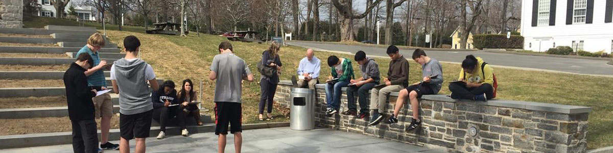 Group of students work on the patio at the Aldrich
